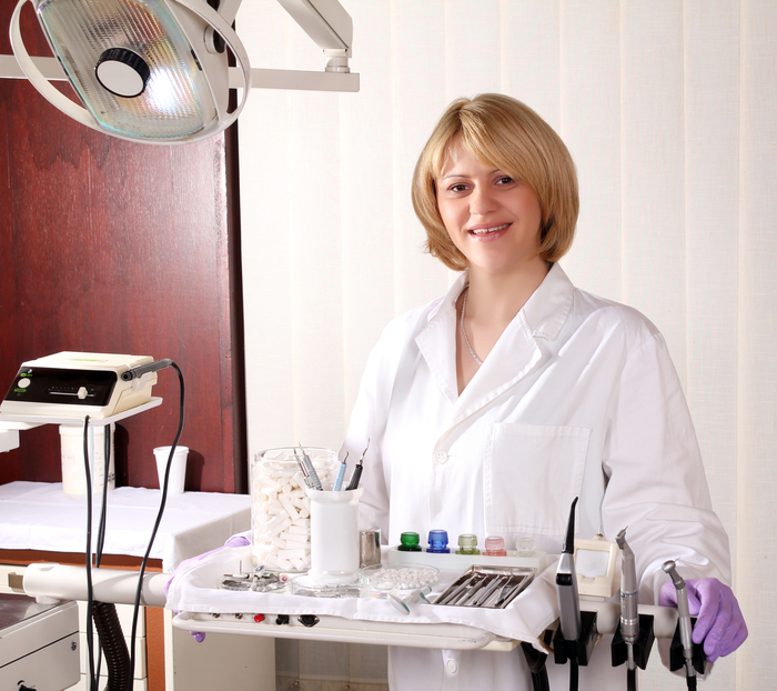 female dentist with medical equipment